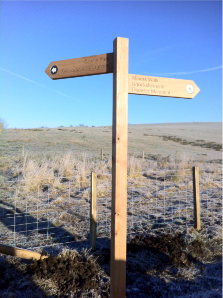 image of wooden finger post sign right of way direction